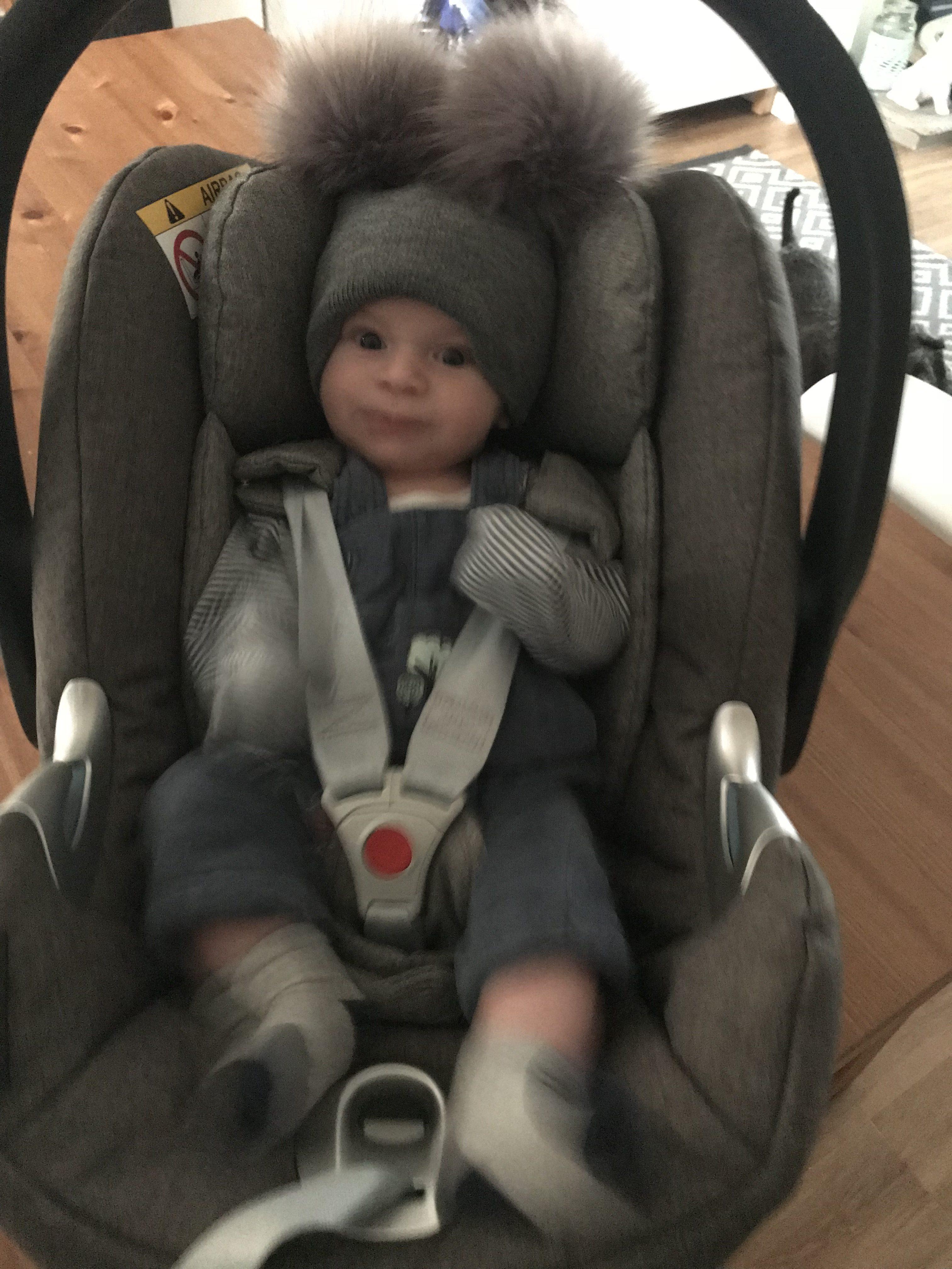 Jasper in a car seat
