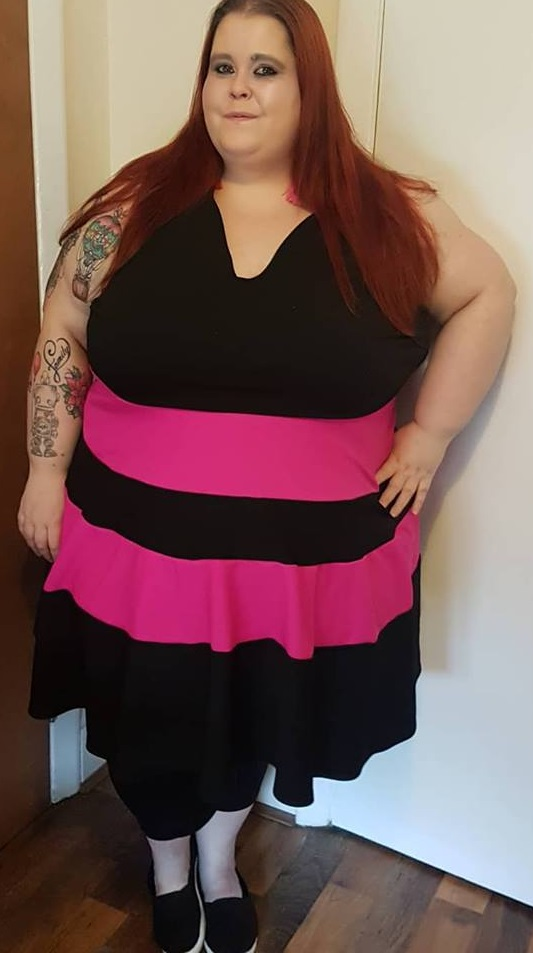 new dress, Debz, size 32, wearing a black and pink dress